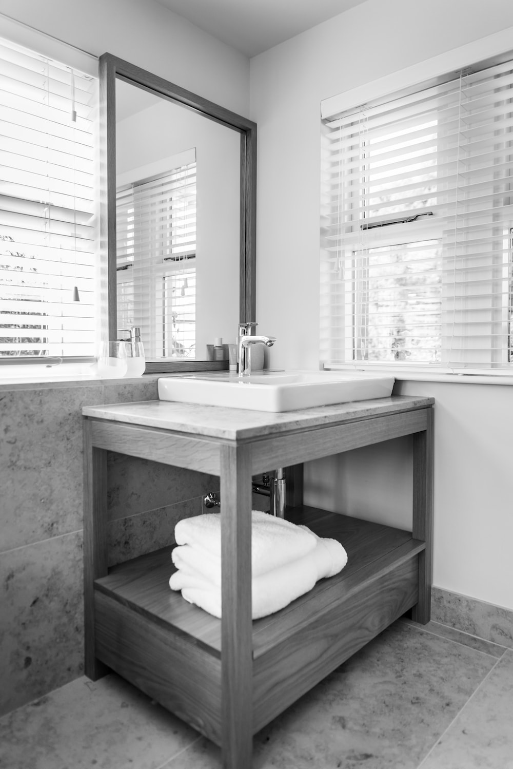 A monochrome image of the house bathroom basin,